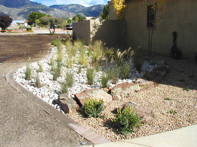 Mediterranean landscape design red twig studio for Landscaping rocks albuquerque